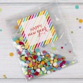 New Year's Eve confetti for your guests using cellophane bags and colorful seals